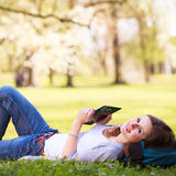 Young woman using her tablet computer Stock Photography
