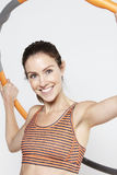 Young woman using a hula hoop, smiling Stock Photography