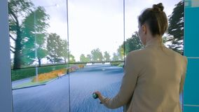 Young woman using interactive bicycle simulator machine