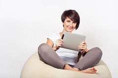Young woman using iPad Royalty Free Stock Photography