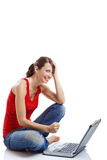 Young woman using a laptop Royalty Free Stock Images