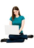 Young woman using a laptop Stock Image