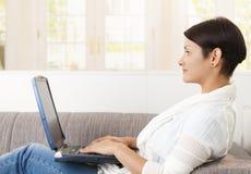 Young woman using laptop Stock Photos