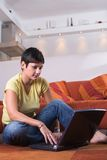 Young woman is using a laptop Royalty Free Stock Image
