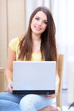 Young woman using laptop. Happy young woman using laptop at home Stock Photos