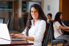 Young woman using a laptop Royalty Free Stock Image