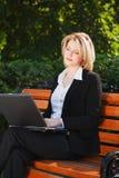 Young woman using laptop Royalty Free Stock Photos
