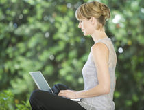 A young woman using a laptop Royalty Free Stock Image