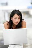 Young woman using laptop. Young asian woman using laptop, smiling, portrait Stock Images