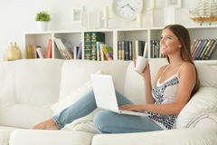 Young woman using  laptop Royalty Free Stock Image