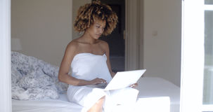 Young Woman Using Laptop On Bed Stock Image