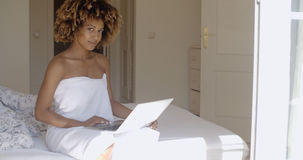 Young Woman Using Laptop On Bed Stock Photos