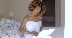 Young Woman Using Laptop On Bed Stock Images