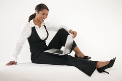 Young Woman Using Laptop and Blue Tooth Stock Photo