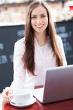 Woman using laptop in cafe Stock Photos