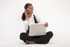 Young Woman Using Laptop and Cell Phone Royalty Free Stock Photo