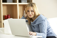 Young Woman Using Laptop Computer Stock Photos