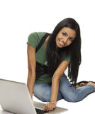 Young woman using laptop computer. Royalty Free Stock Photo