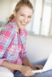 Young Woman Using Laptop Computer At Home Stock Image