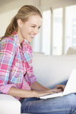 Young Woman Using Laptop Computer At Home Royalty Free Stock Image