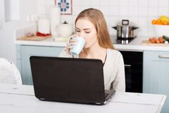 Young woman using a laptop computer at home Stock Image