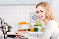 Young woman using a laptop computer at home Royalty Free Stock Photo