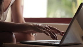 Young woman using laptop computer at home stock video footage