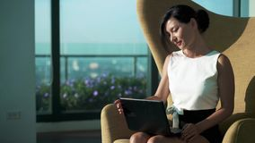 Young woman using laptop, high business interior stock footage