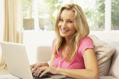 Young Woman Using Laptop At Home Stock Photos