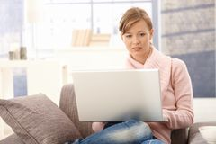 Young woman using laptop at home Stock Photography