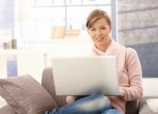 Young woman using laptop at home Royalty Free Stock Image