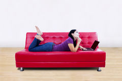 Young woman using laptop at home Stock Image