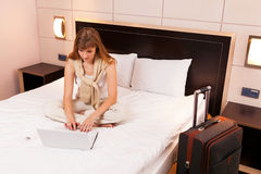 Young woman using laptop in hotel Royalty Free Stock Images