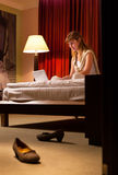 Young woman using laptop in hotel Stock Images