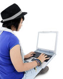 Young woman using laptop, isolated on white Royalty Free Stock Photos