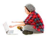 Young woman using a laptop and looking sadness Stock Image