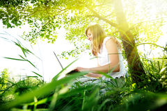 Young woman using Laptop on nature Royalty Free Stock Photo
