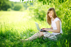 Young woman using Laptop on nature Royalty Free Stock Images