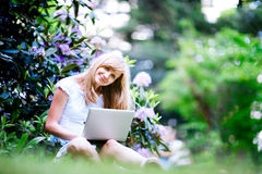 Young woman using Laptop on nature Stock Photography