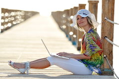 Young woman using laptop outdoor in summer Royalty Free Stock Photos