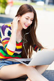 Young woman using laptop outdoors Stock Image
