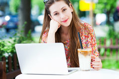 Young woman using laptop outdoors Stock Photography
