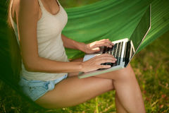 Young Woman Using Laptop Outdoors Royalty Free Stock Photography