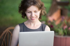 Young woman using laptop outdoors royalty free stock photo