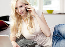 Young woman using Laptop and phone Royalty Free Stock Photo