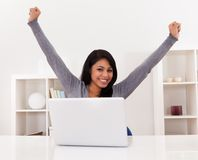 Young woman using laptop. Portrait Of Excited Happy Young Woman Using Laptop Royalty Free Stock Photography
