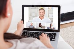 Young woman using laptop for videochatting Stock Photo