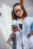 Young woman using listening song and using mobile phone Stock Photos
