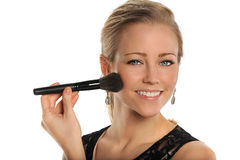 Young woman Using Makeup Brush Stock Photo