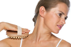 Young woman using massager Stock Photography